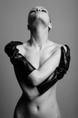 nude elegant girl with the gloves. Studio fashion photo.