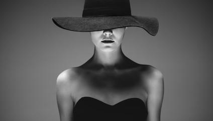 Beautiful elegant woman in a hat