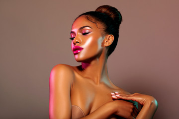 Beauty portrait fashion girl with color lighting filters. Beauty girl face close up. Closeup African American woman with copy space. neon light blue and pink color. - image.