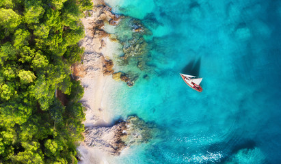 Croatia. Panoramic coast and yacht as a background from top view. Turquoise water background from top view. Beach and waves. Travel - image