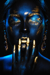 Portrait of a beautiful girl with an exquisite fantasy makeup in the style of legends about ancient greece and pharaohs